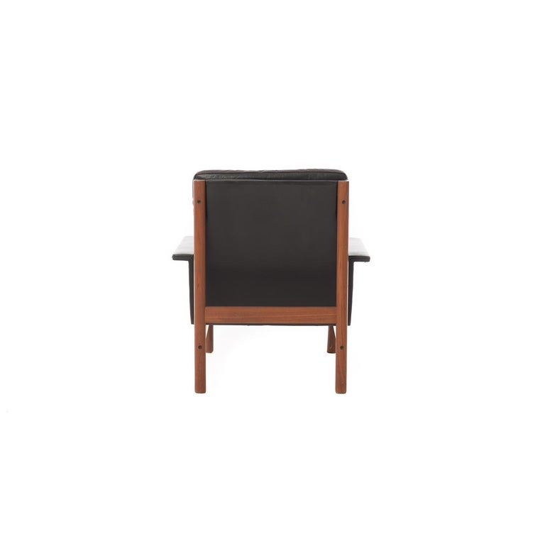 20th Century Danish Modern Easy Chair and Ottoman in Black Leather