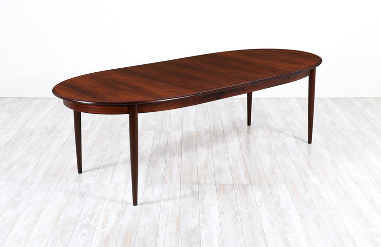 Danish modern expanding rosewood dining table by Gudme Møbelfabrik.