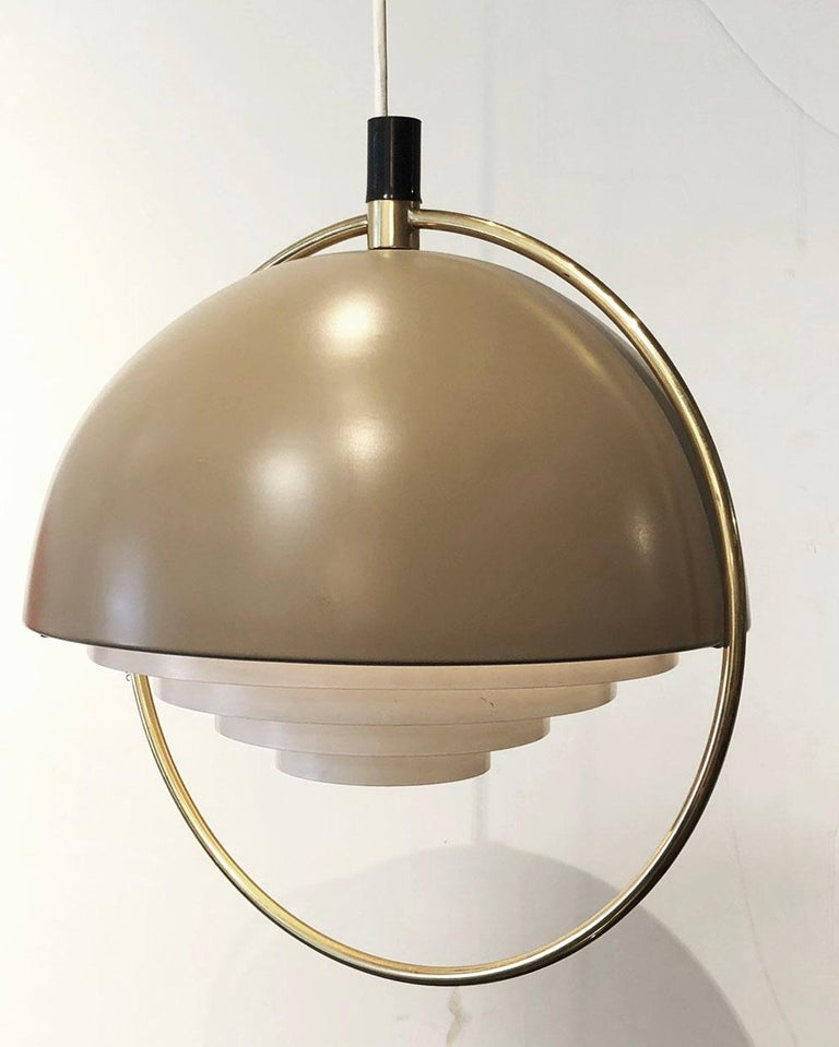 Danish modern hanging light. This is an original Mid-Century Modern design. The design disperses light evenly.    Complementary delivery in the Los Angeles / Beverly Hills area. Pick up is also an option.