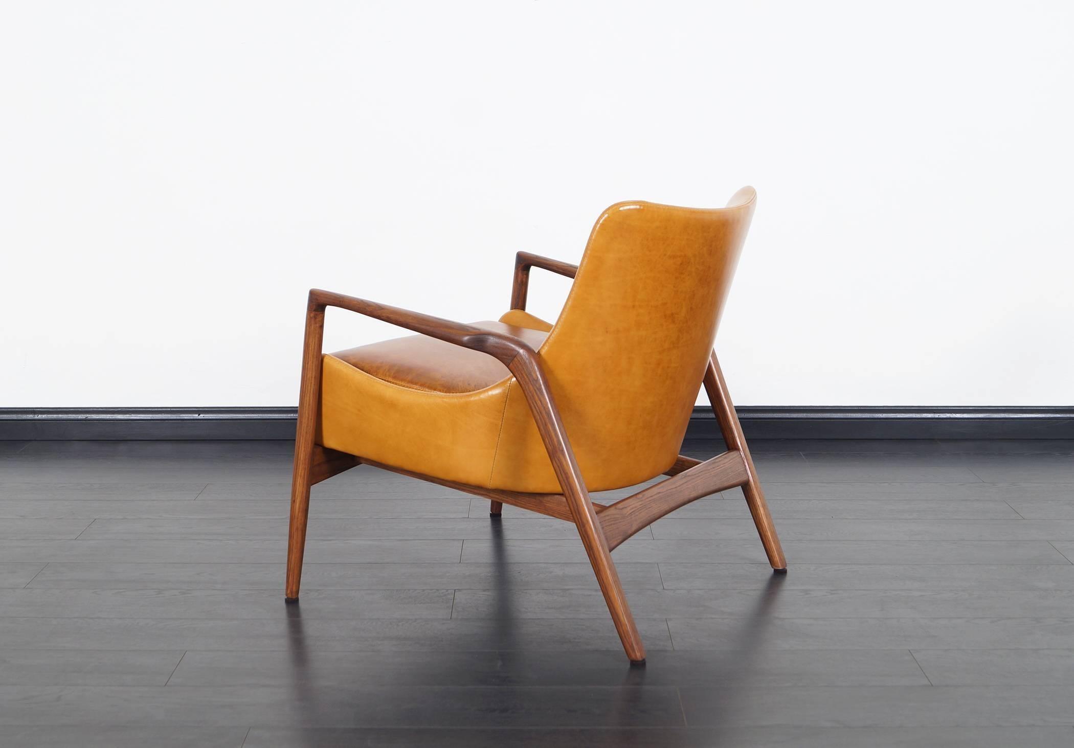 & Danish Modern Leather Lounge Chairs by Ib Kofod Larsen at 1stdibs