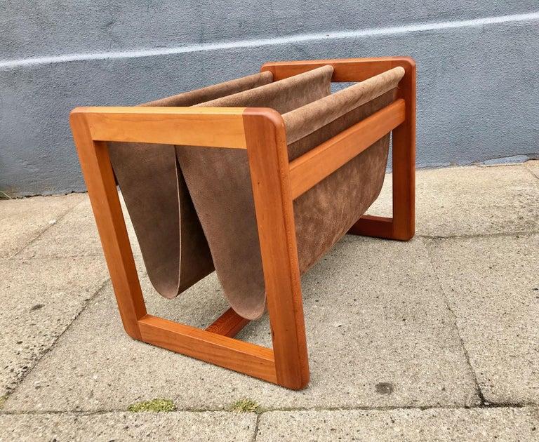Magazine holder designed by Danish Aksel Kjersgaard in the 1960s. Dual brown suede leather cradle slings. Solid teak frame. Branded