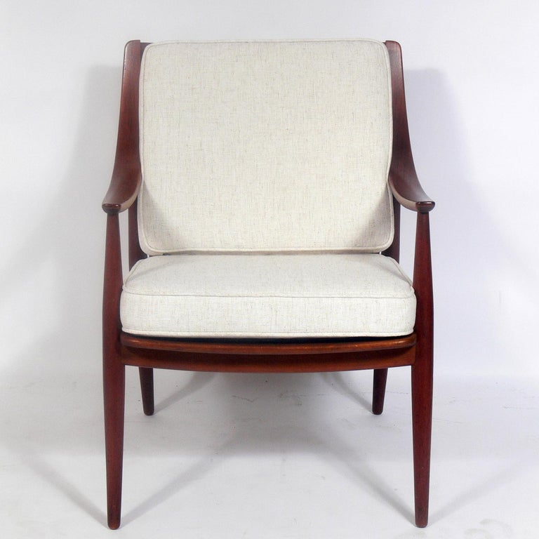 Danish modern lounge chair, designed by Peter Hvidt & Orla Mølgaard Nielsen for France & Daverkosen and retailed by John Stuart of NYC, circa 1960s. It has been reupholstered in an ivory color herringbone fabric. It retains it's original finish and