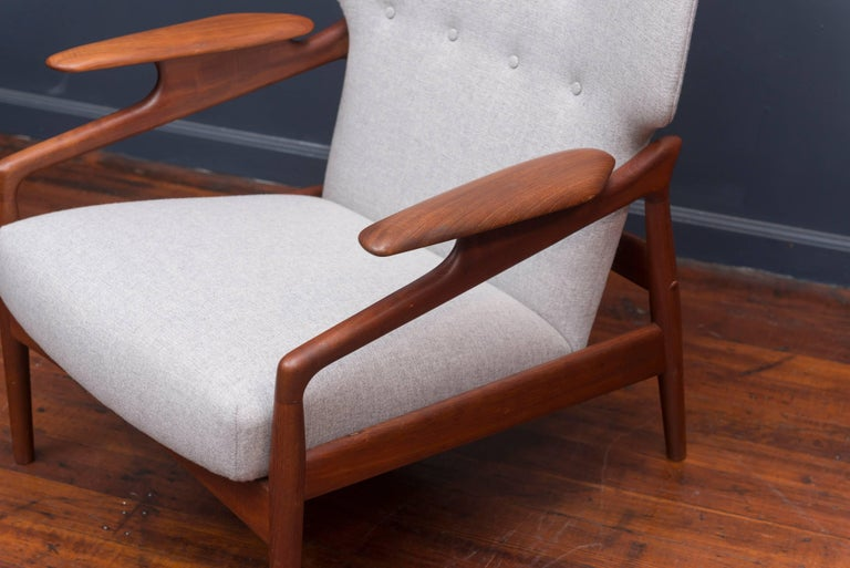 Danish Modern teak adjustable lounge chair, newly upholstered and refinished.