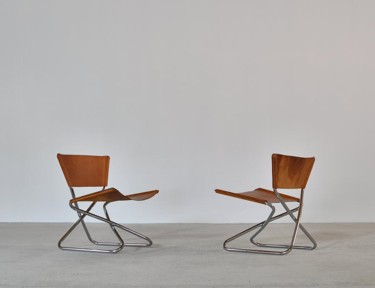Scandinavian Modern Danish Modern Lounge Chairs in Saddle Leather and Steel by Erik Magnussen For Sale