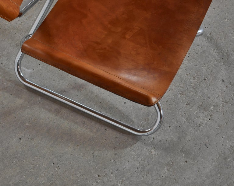 Danish Modern Lounge Chairs in Saddle Leather and Steel by Erik Magnussen For Sale 1