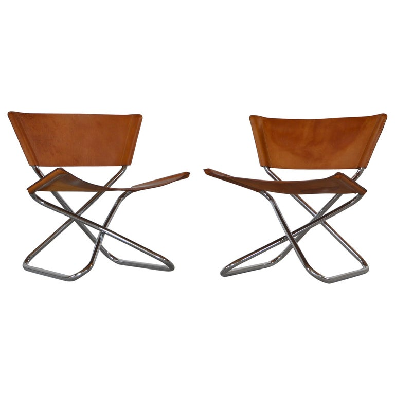 Danish Modern Lounge Chairs in Saddle Leather and Steel by Erik Magnussen For Sale