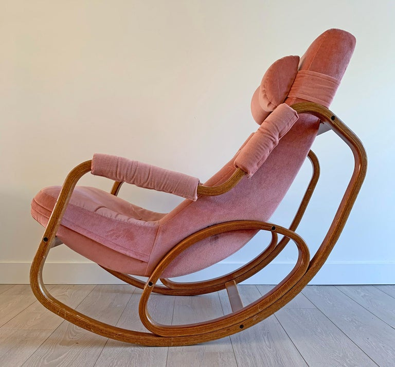 This rocking chair is absolutely stunning! With whimsical round lines and bentwood, this Danish modern lounge chair / rocking chair is a must have. The chair features its original bow-tie shaped head rest and is upholstered in a blush pink velvet.