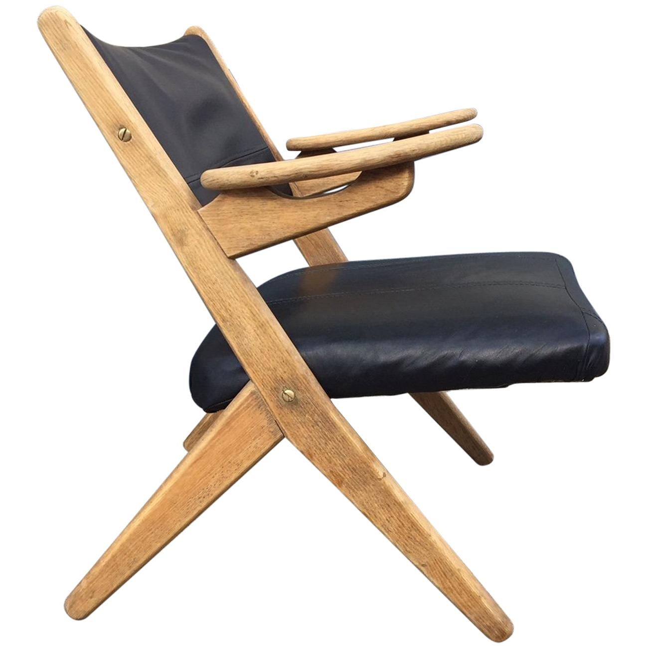 Danish Modern Oak and Black Leather Lounge Chair by Arne Hovmand Olsen, 1960s