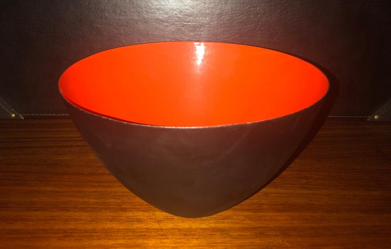 Danish modern orange / black enamel Krenit bowl by Herbert Krenchel for Torben Orskov, circa 1950s. Beautiful color and condition on this vintage piece with no chips to the enamel, but some minor wear on the outside of the bowl. Signed on the