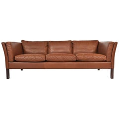 Danish Modern Patinated Rust Toned Leather Three-Seat Leather Sofa