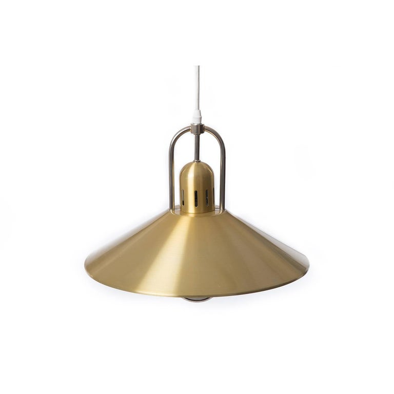 This brass-plated aluminium pendant casts ample light for your dining table, workspace, etc.