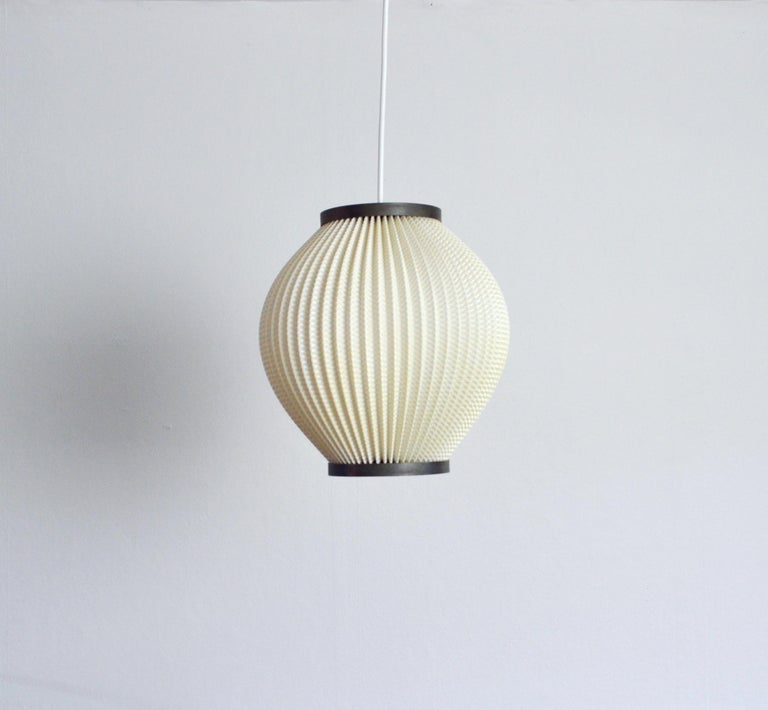 Pendant in white pleated acrylic, designed by Lars Ejler Schiøler. 