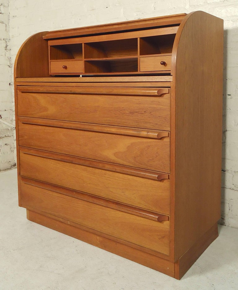 Mid-century modern teak dresser with a roll top that exposes a pull out desk. Great for small rooms or children's bedrooms.  (Please confirm item location - NY or NJ - with dealer)