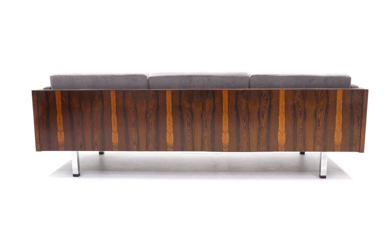 Brazilian rosewood even arm case sofa by Jydsk Mobelvaerk, Denmark. We also have a listing for a matching pair of loveseats and a chair. This design is similar to those by Milo Baughman. Added touches with this design are 1 and 1/2 inch square