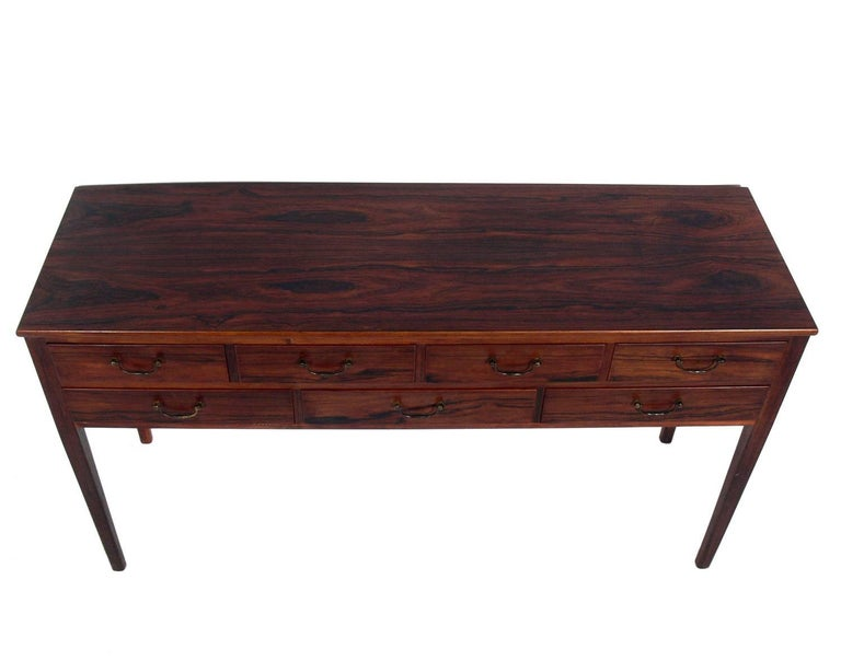 Danish modern rosewood console, designed by Ole Wanscher for A.J. Iversen and retailed by Illums Bolighus, Denmark, circa 1940s. It is a versatile size and can be used as a console table, server, media cabinet or bar.