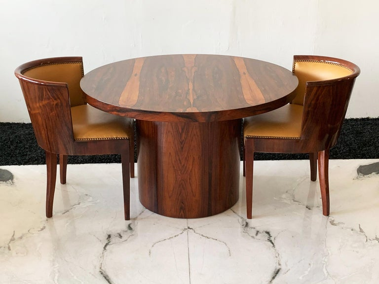 Available right now I have this stunning Danish modern rosewood dining or game table. This table is simply stunning! There is a breathtaking rosewood grain throughout on a great circular drum base.  This table measures a little lower than most
