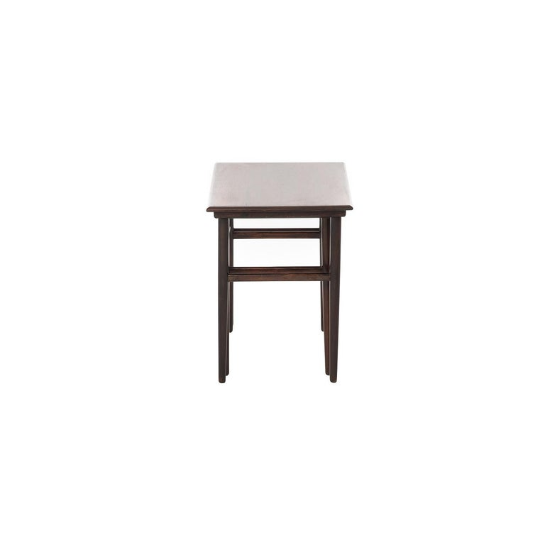 Two rosewood tables with sleek tapered legs nest for optimal storage or can be used separately to accommodate your needs.