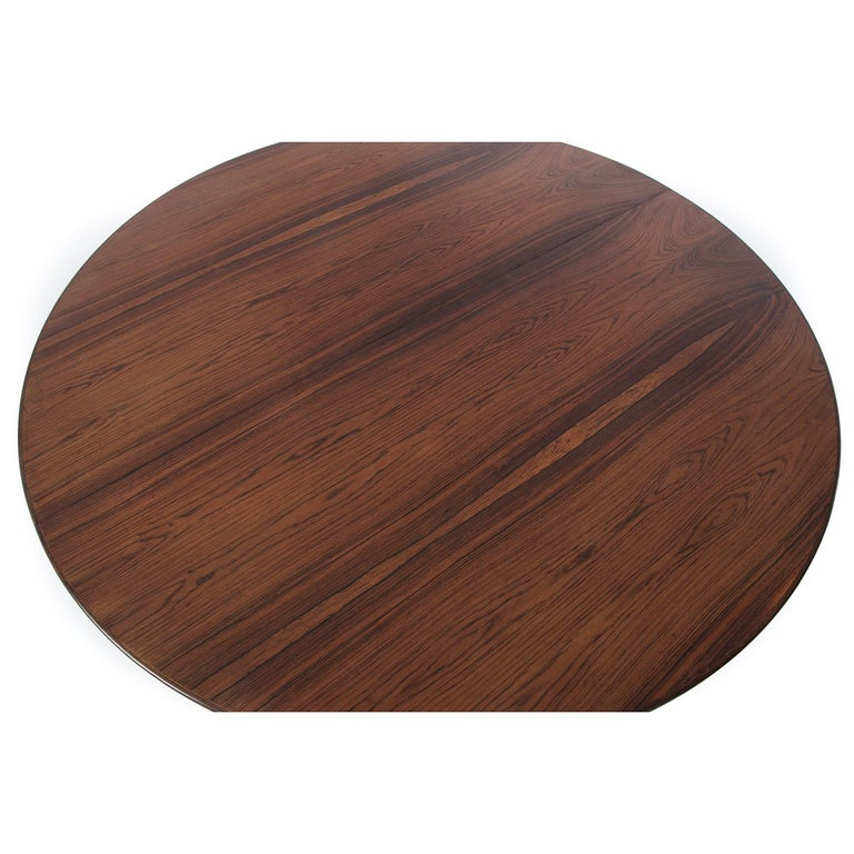 Scandinavian Modern Danish Modern Rosewood Round to Oval Dining Table with Two Leaves