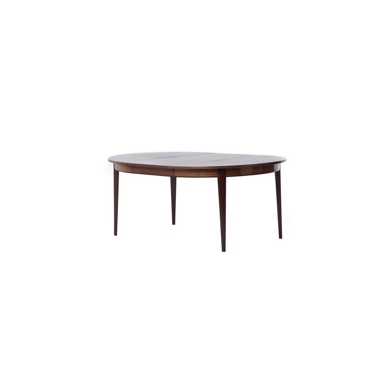 Danish Modern Rosewood Round to Oval Dining Table with Two Leaves In Excellent Condition In Minneapolis, MN