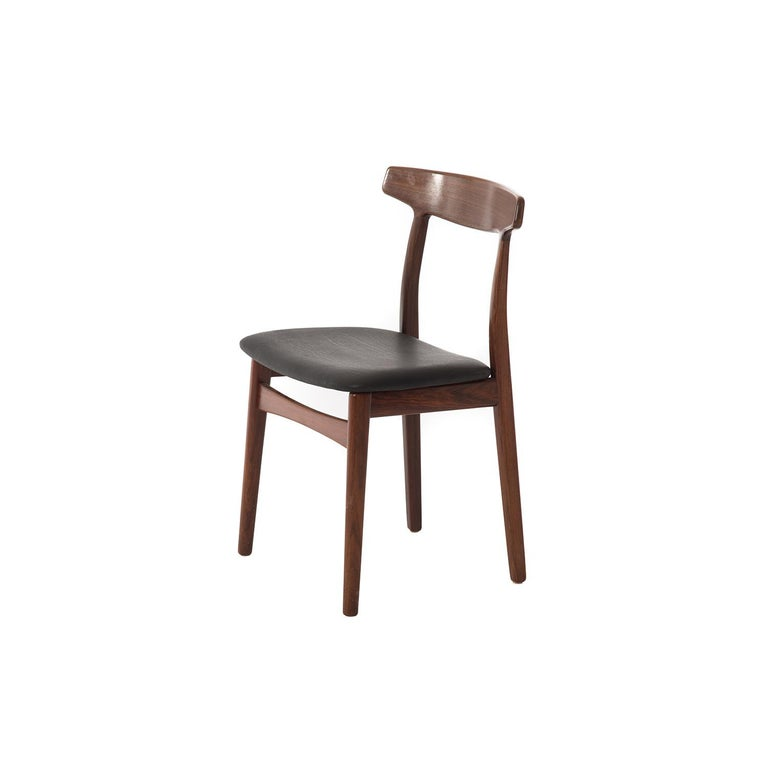 This sculptural chair will lend elegance to any room. Lacquer semi-gloss finish with matte black leather seat.