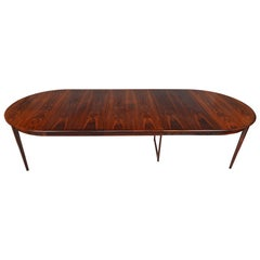 Danish Modern Round Rosewood Table with Three Leaves by Moreddi