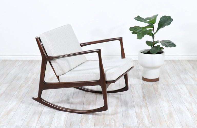 Danish modern sculpted rocking chair by Ib Kofod-Larsen for Selig.