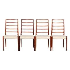 Danish Modern Set of Four Dining Chairs Designed by N.O. Møller for J.L. Møller