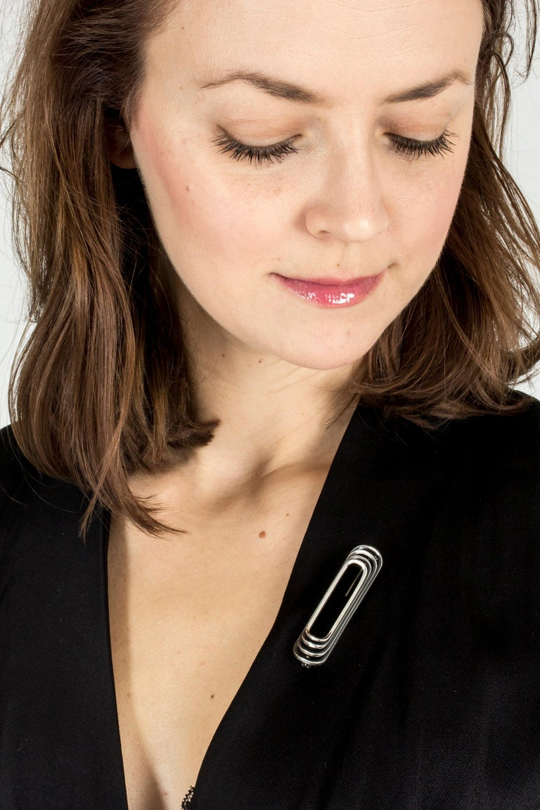 Sleek and elegant silver brooch from Hans Hansen in a rectangular shape with rounded corners.