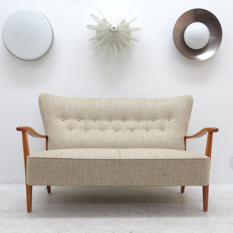 Wonderful Danish modern sofa by DUX, sculptural stained beech frame with professionally reupholstered body, The concave wing back is tufted and the seat is spring supported, marked. (see also LU848711950491 for matching highback chair &