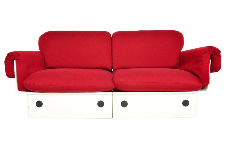 Designed at the height of the Space Age, this Danish modern loveseat offers a stunning silhouette and lounge worthy seating. A molded, white lacquer wood frame holds six cushions. Inside the frame, four casters allow this piece to be easily