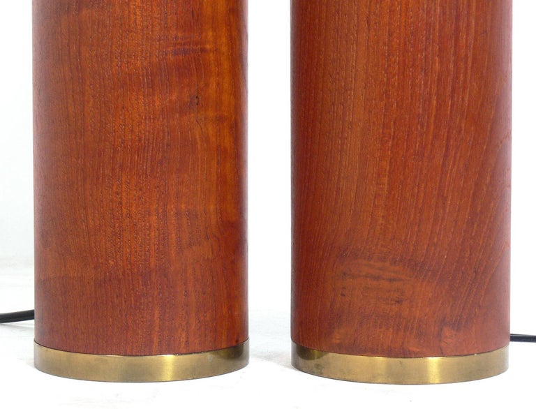 Danish Modern Teak and Brass Lamps, Denmark, circa 1960s They retain their warm original patina. They have been rewired. The price noted below INCLUDES the shades.