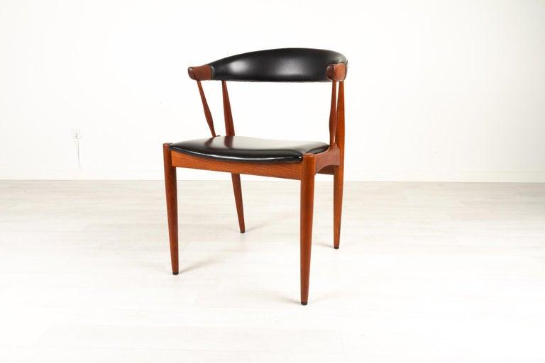 Danish modern teak armchair by Johannes Andersen for Brdr. Andersen 1960s Model BA113 armchair designed by Danish architect Johannes Andersen and manufactured by Brdr. Andersens Møbelfabrik, Vejen. Sculptural design with organic lines. Round