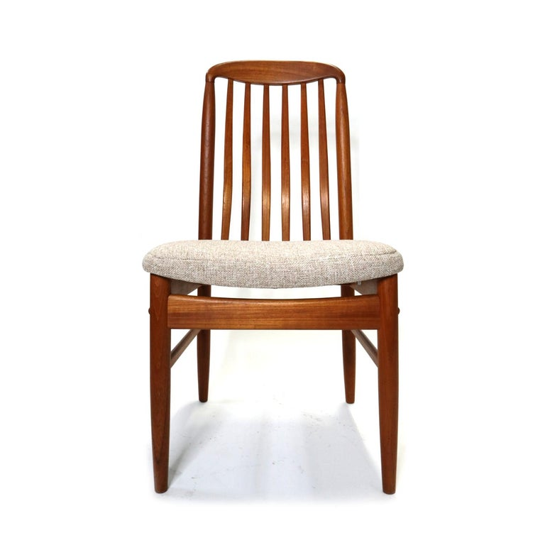 Set of four pre-owned Danish modern style BL10 chairs by Benny Linden. Crafted in South Asia, made of hand sanded solid teak and European hardware. These chairs are as comfortable as they are beautiful with the contoured back rest supporting the