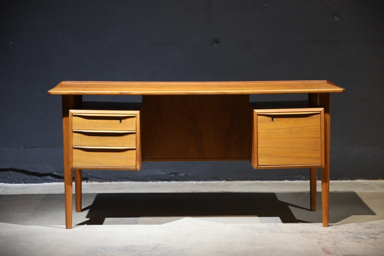 Warmth with wood. A wonderful Danish teak desk by Peter Løvig Nielsen. Retains makers stamp.