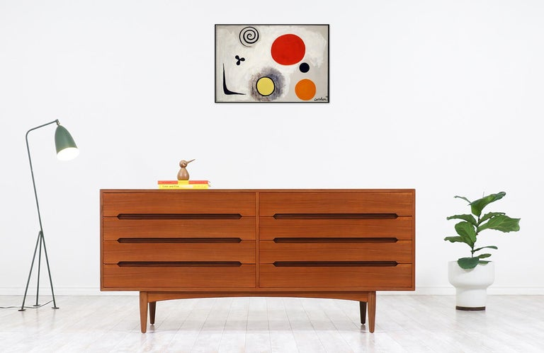 Elegant modern dresser designed and manufactured by E.W. Bach in Denmark circa 1950s. This Danish Modern teak dresser features eight drawers with dovetailed joinery and carved pulls showcasing impeccable craftsmanship, bringing a beautiful