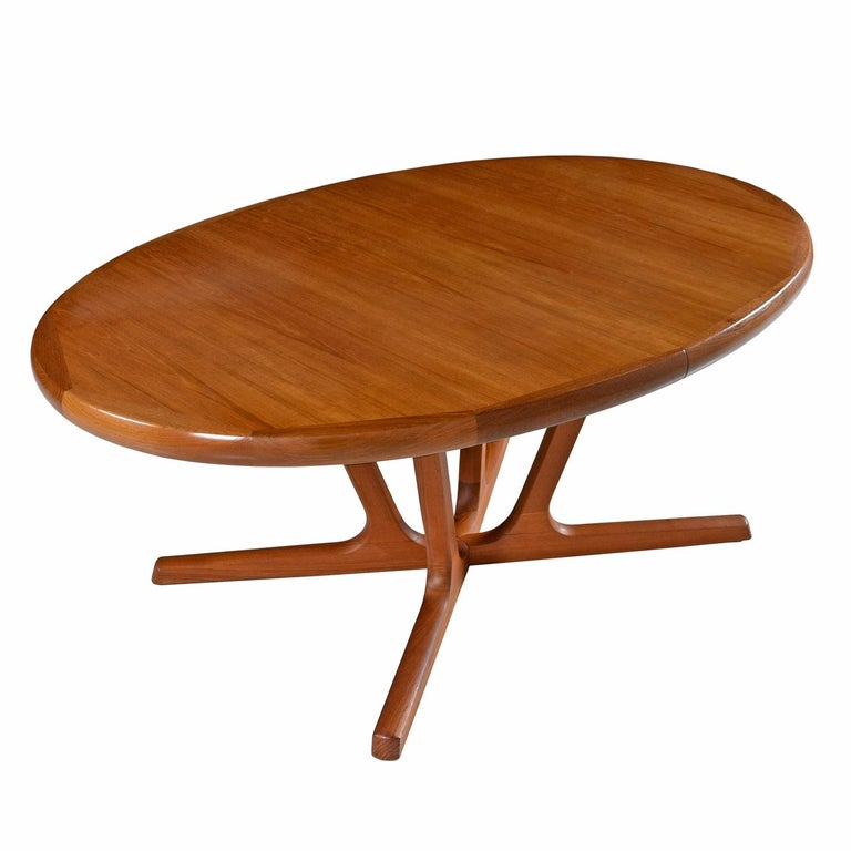 Made in Denmark by Interform collection, this vintage teak dining table features two leaf inserts to expand the length. Take note of the beautiful tiger stripe effect old growth teak wood and thick, solid edge band that elegantly frames the