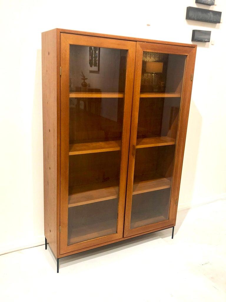 Danish Modern Teak Glass Bookcase by Dyrlund on Solid Iron Base For Sale 1