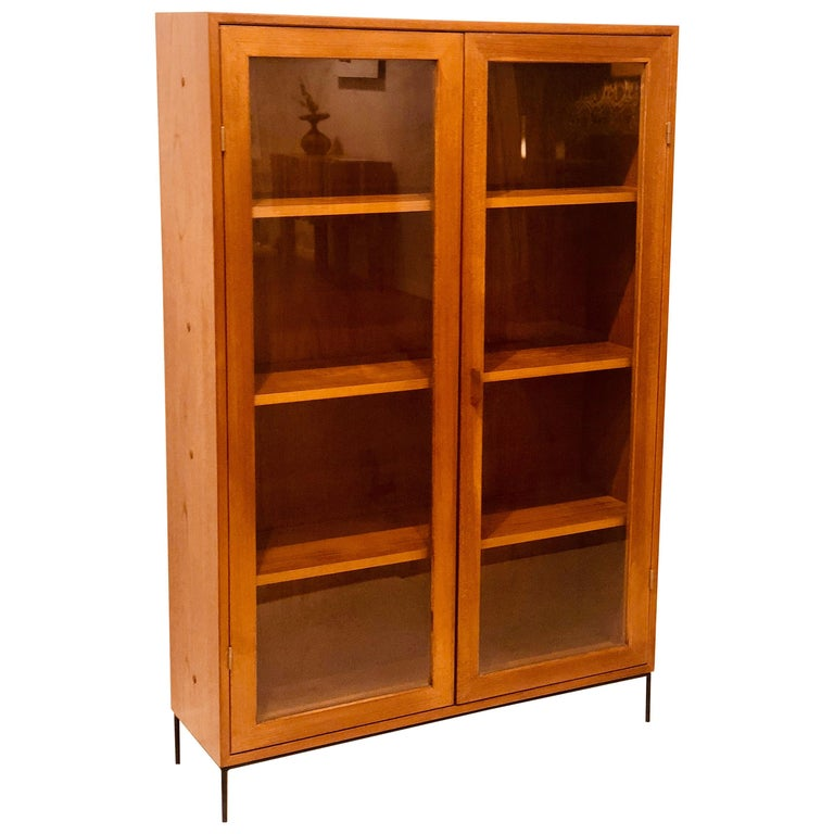 Danish Modern Teak Glass Bookcase by Dyrlund on Solid Iron Base For Sale