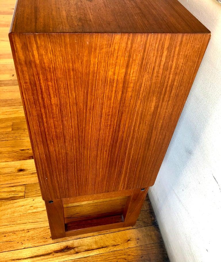 Scandinavian Modern Danish Modern Teak and Glass Low Bookcase / Cabinet by Gunni Omann For Sale
