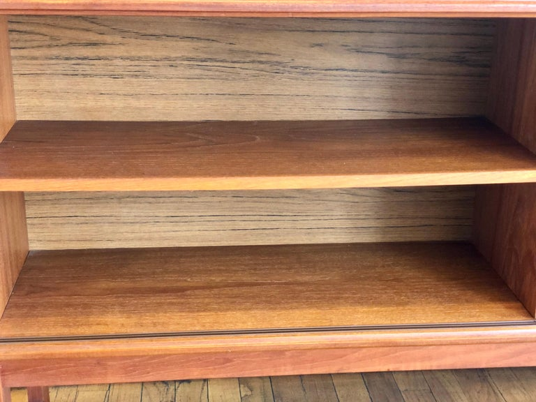 Danish Modern Teak and Glass Low Bookcase / Cabinet by Gunni Omann In Good Condition For Sale In San Diego, CA