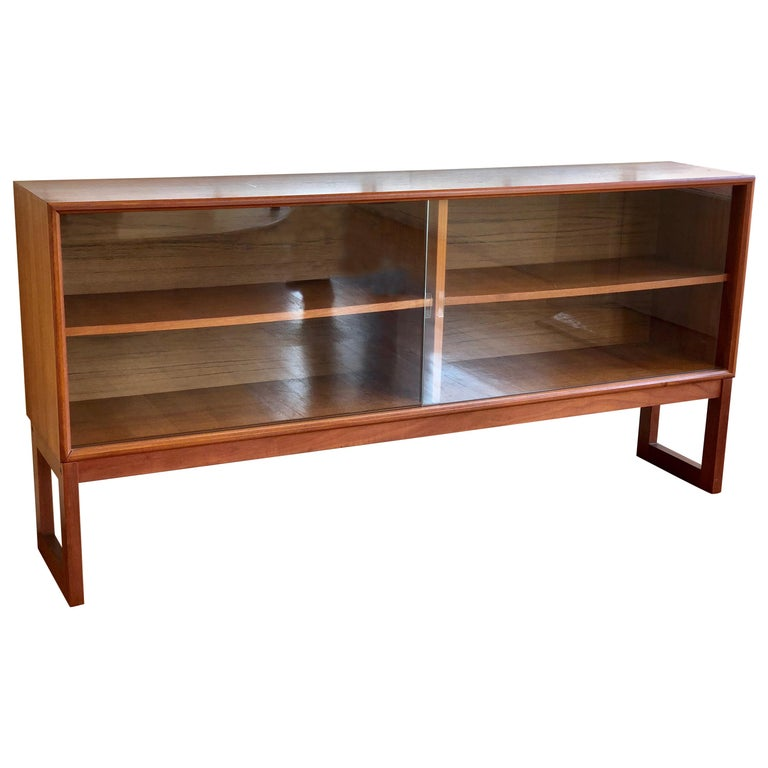 Danish Modern Teak and Glass Low Bookcase / Cabinet by Gunni Omann For Sale