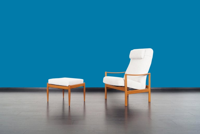 Danish modern reclining lounge chair and ottoman manufactured in Denmark, circa 1960s. This comfortable recliner features a newly upholstered seat and ottoman. The seat is supported by a solid teak frame with a unique mechanism that allows you to