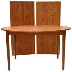 Danish Modern Teak Round Dining Table with Two Leaves