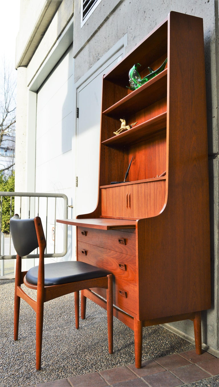 This impeccable Danish modern teak secretary is a quality construction designed by Johannes Sorth for Bornholm Mobelfabrik in the 1960s. Made of teak veneer with all hardwood construction, it has so many handy design features! Firstly, the handy