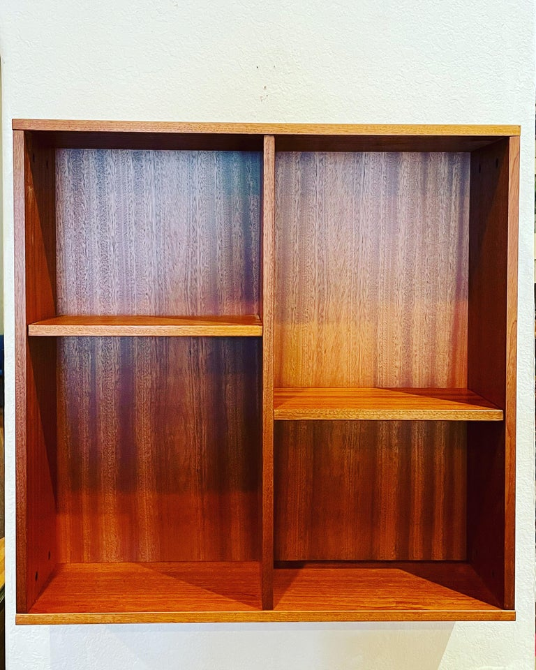 Versatile Danish modern wall hanging cabinet in teak with removable shelves each side its 14