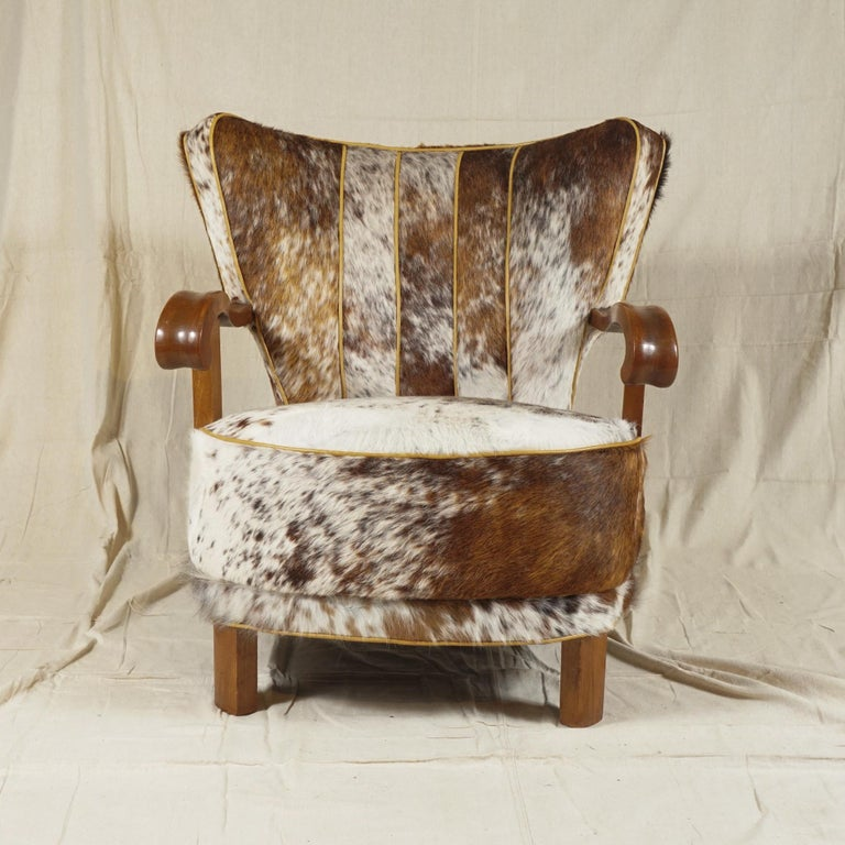 A sturdy, Danish modern easy armchair from 1940s recovered in patterned soft cowhide, with strong, curved oak arms just in the right place and most comfortable to sit in. Great for study, library or living room.