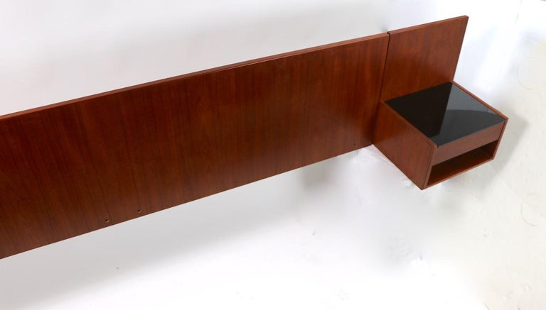 Rare and unusual wall mount headboard designed by Hans Wegner for GETAMA. Large headboard will accommodate up to a California King Size mattress, total W 110.75 x interior W 89.50in. (between nightstand units ). Long teak board flanked by one drawer