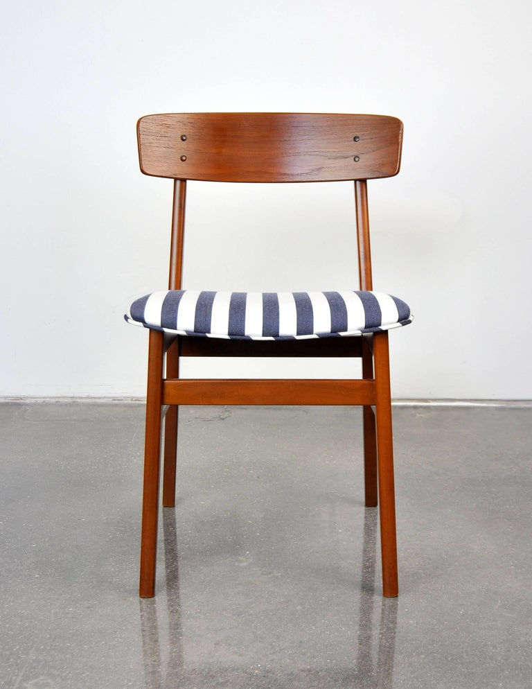 A 1960s Mid-Century Modern vintage side chair; can be used as a desk, dining or accent chair. The seat was recently recovered in a nautical style blue and white striped fabric. The solid teak frame shows rich, deep patina. Please contact Select
