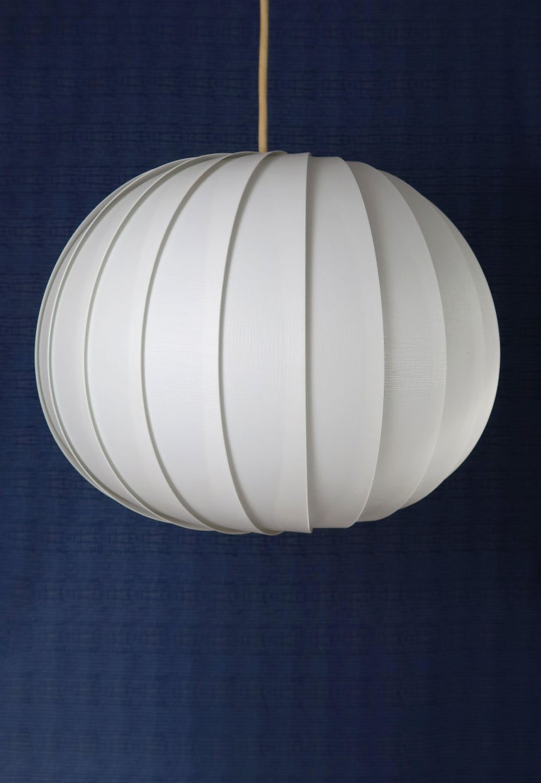 Scandinavian Mid-Century Modern spherical white acrylic pendant consisting of layered white, textured strips gathered on top and bottom. Designed in 1972 by Lars Eiler Schiøler (1913-1982) for Høyrup Light. Model