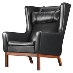 Danish Modern Wingback Lounge Chair in Black Leather + Rosewood